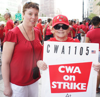 Scabs receiving an unwelcome message from picketing CWA 1101 members