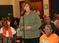 TWU Local 252 Vice President Patricia Bowden discussing concerns of union members at the hearing