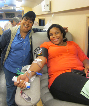 Lisa Rivera of Local 338 inside the Bloodmobile with a Local 338 member donating. 45 pints of blood were collected September 23rd outside the Queens Center Mall