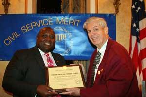 MCU Board Member Richard Wagner (right) presents award to MCU Board Chairman Mark S. Brantley